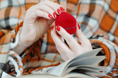 Close up of female hands holding red heart. Close up of female hands holding red heart royalty free stock photography
