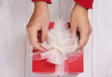 Close up on female hands holding red present with white Ribbon . Gift box packaging. Birthday, New year, Valentine's Day, 8 march, Stock Image