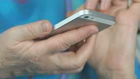 Close up of female hands holding the smartphone stock footage
