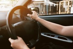 Close up female hands holding on steering wheel. Woman driving a car. Happiness Concept. Travel Royalty Free Stock Image