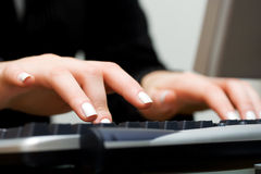 Business woman typing on computer keyboard Royalty Free Stock Images