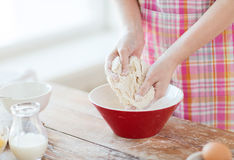 Close up of female hands kneading dough at home Stock Photo