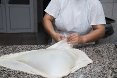 Close up of female hands kneading dough and making banitsa Stock Image