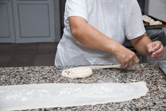 Close up of female hands kneading dough and making banitsa Stock Images