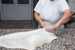 Close up of female hands kneading dough and making banitsa Royalty Free Stock Images