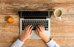 Close up of female hands with laptop and coffee Stock Image
