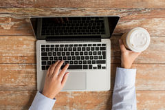 Close up of female hands with laptop and coffee Stock Photo