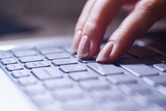 Close-up of female hands on the laptop keyboard Stock Photo