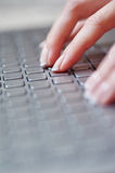 Close-up of female hands on the laptop keyboard Royalty Free Stock Images