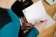 Close-up of female hands making notes in the notepad at office Royalty Free Stock Photos