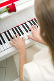 Close up of female hands playing piano Stock Photos