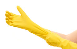 Close up of female hands putting on yellow protective rubber gloves against white Royalty Free Stock Images