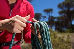 Close up female hands with rope on mountain Stock Photography