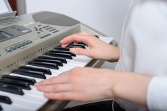Close-up of female hands with sequencer stock photos