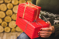Close up of female hands with small red gift boxes Royalty Free Stock Images