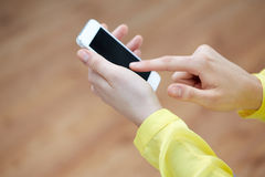 Close up of female hands with smartphone at home Stock Photo