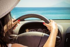 Close up of female hands on steering wheel stock images