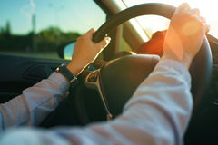 Close-up of female hands on the steering wheel Royalty Free Stock Photography