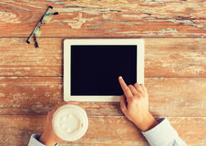 Close up of female hands with tablet pc and coffee Stock Images