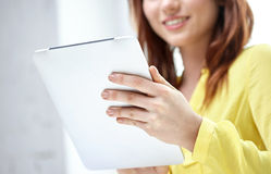 Close up of female hands with tablet pc Royalty Free Stock Image