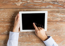 Close up of female hands with tablet pc on table Stock Photo