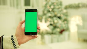 Close-up of female hands touching green screen on mobile phone. Chroma Key. Close up. Tracking motion. Vertical.with. NEW YORK - January 17, 2015: Close-up of stock footage