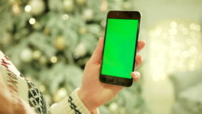 Close-up of female hands touching green screen on mobile phone. Chroma Key. Close up. Tracking motion. Vertical.with. NEW YORK - January 17, 2015: Close-up of stock video