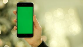 Close-up of female hands touching green screen on mobile phone. on the mobile devices green screen.Green screen Chroma. NEW YORK - January 17, 2015: Close-up of stock footage
