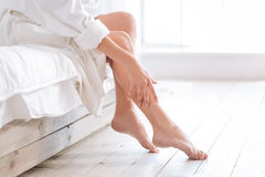 Close up of female hands that touching legs Stock Photo