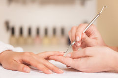 Close up of female hands on towel at spa salon. Stock Photos