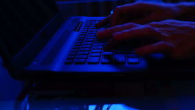 Close up female hands typing on laptop keyboard in the evening. Real time stock video