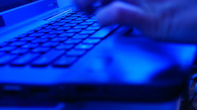 Close up female hands typing on laptop keyboard with sound. Close up female hands typing on blue laptop keyboard and moving mouse stock video footage