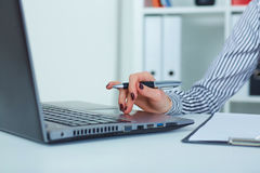 Close up of female hands typing on laptop keyboard. Royalty Free Stock Image