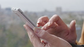 Close-Up Of Female Hands Using Smartphone. Young Woman Hands Writing Text Message On Her Small Smart Phone stock video