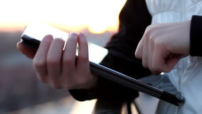 Close up of female hands using tablet computer on the balcony stock footage
