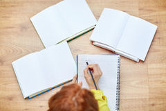 Close up of female hands writing to notebook Royalty Free Stock Photography
