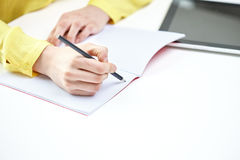 Close up of female hands writing to notebook Royalty Free Stock Images