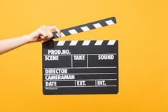 Close up female holding in hand classic director clear empty black film making clapperboard isolated on trending yellow. Close up female holding in hand classic stock images