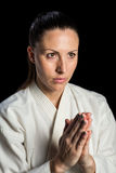 Close-up of female karate fighter meditating Royalty Free Stock Photos