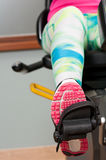 Close-up of female leg wearing sport shoe and pedaling Royalty Free Stock Images