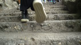 Close up of female legs walking up the stairs. stock video footage