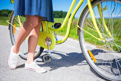 Close up of female legs and vintage bicycle Royalty Free Stock Photography