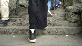 Close up of female legs walking up the stairs. stock video