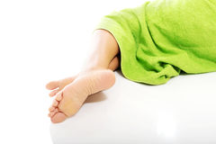 Close up on female legs wrapped in towel Royalty Free Stock Image