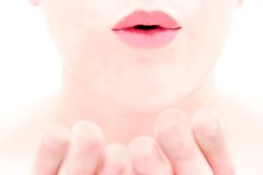 Close up of female lips blowing a kiss. Over white Royalty Free Stock Photo