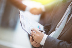 Close-up of female and male hands pointing to a business document while working with him Stock Image
