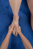 Close up of female masseuse giving a foot massage to man Stock Image