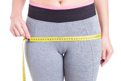 Close-up of female measuring booty line Stock Image