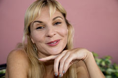 Close up of female model with hand under her chin Royalty Free Stock Image
