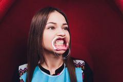 Close up of female mouth with retractor. Doctor flossing the teeth. Dental Gag. Close up of female mouth with retractor. Doctor flossing the teeth. Dental Gag royalty free stock images